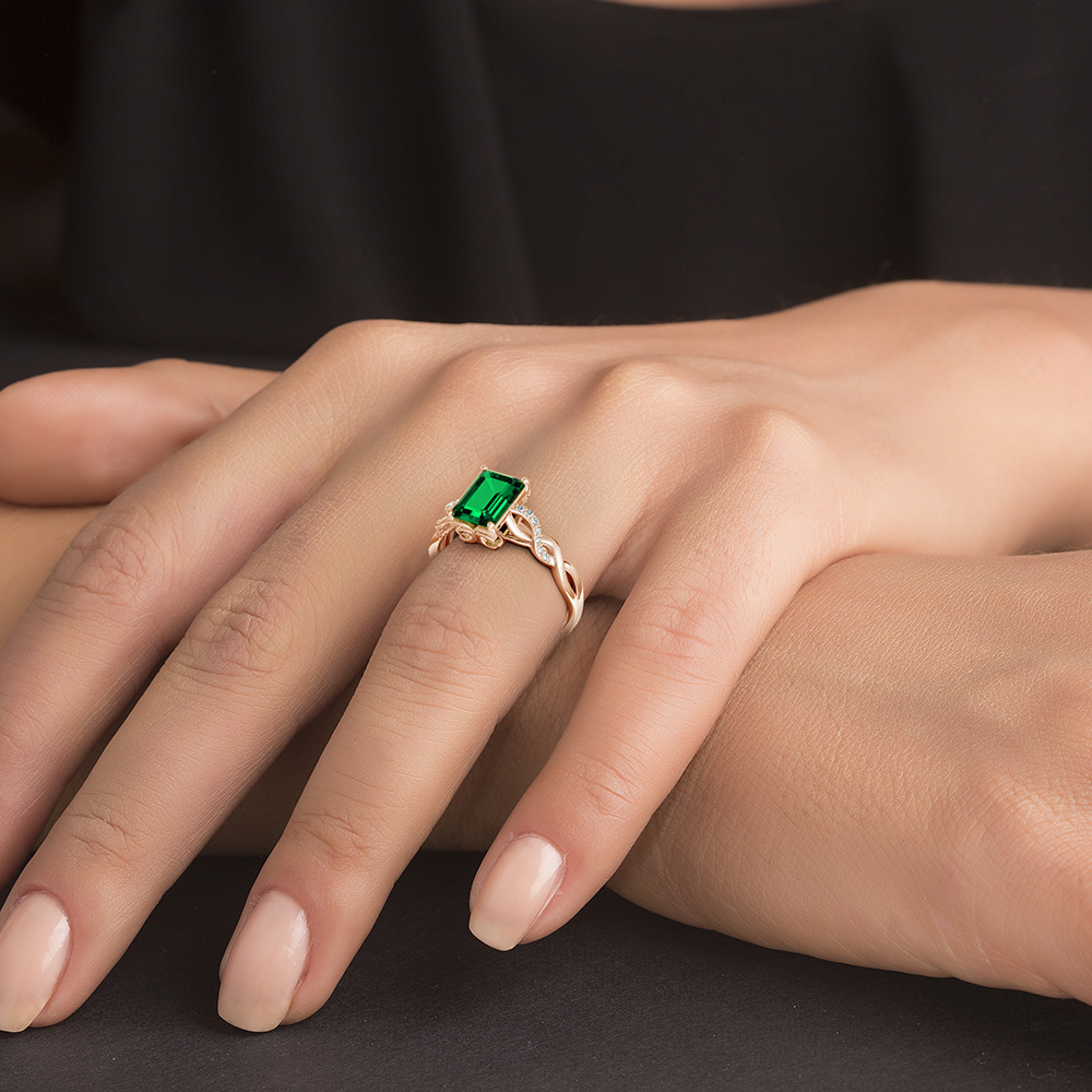 The stunning emerald on the solitaire ring dazzles in a prong setting. To enhance its rich hue like the rainforests, there are diamonds