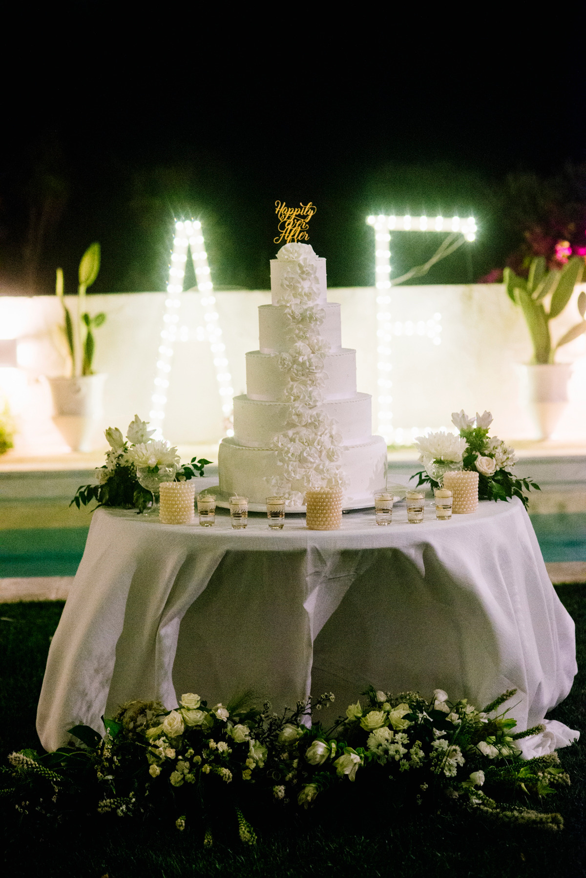 happily ever after topped wedding cake