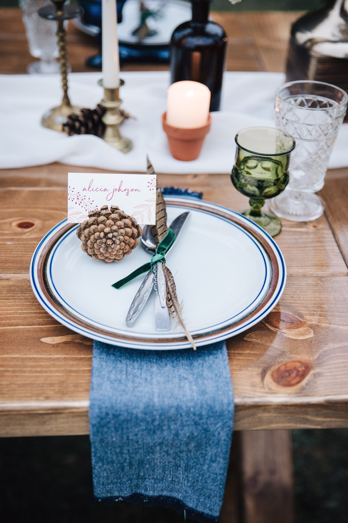 pinecone and feathers place setting decor