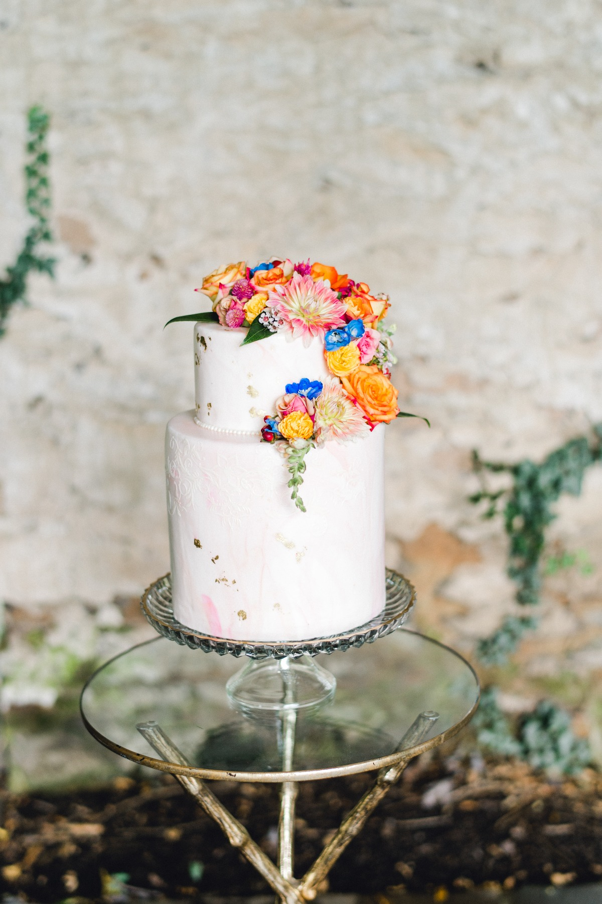Dusty mauve wedding cake with bright florals