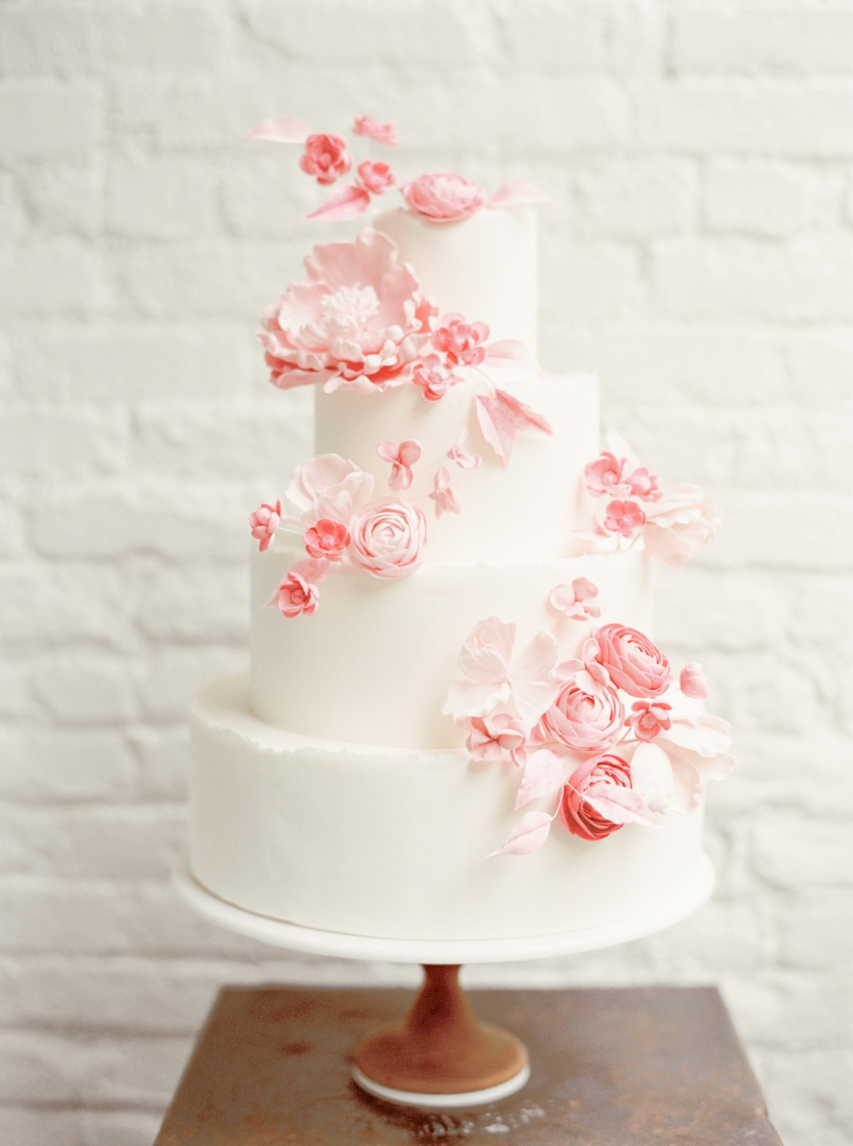 White wedding cake with pink flowers