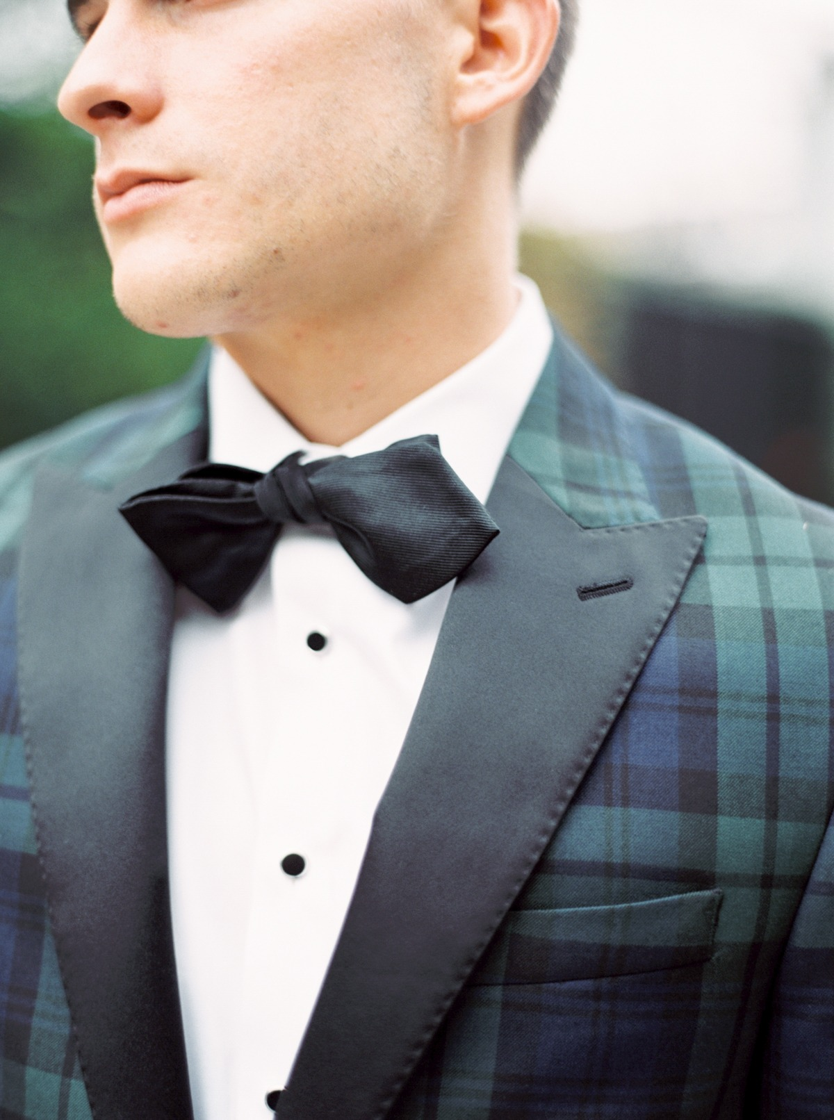 Plaid suit and bow tie