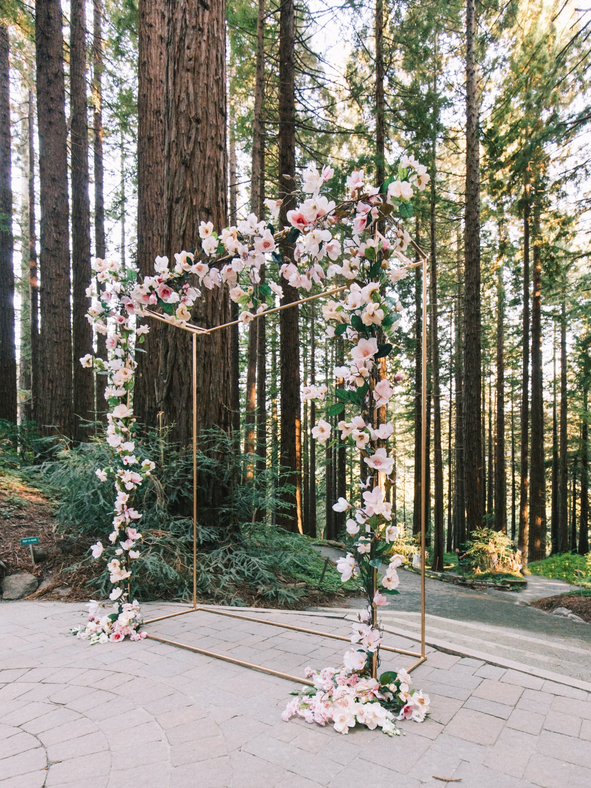 Redwoods ceremony arch with silk magnolias