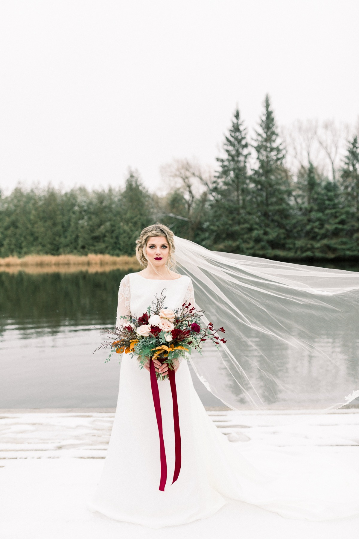 Winter bride with deep red hues