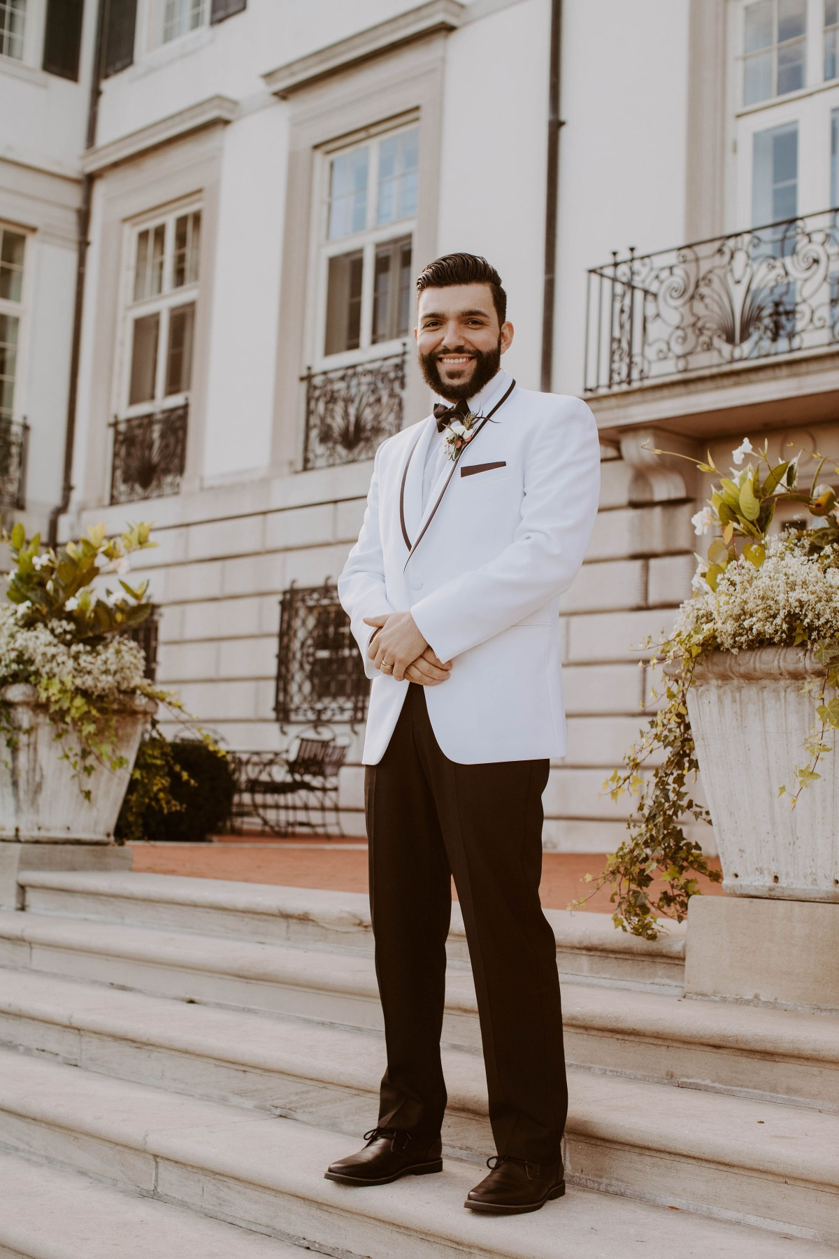Groom in black and white tux