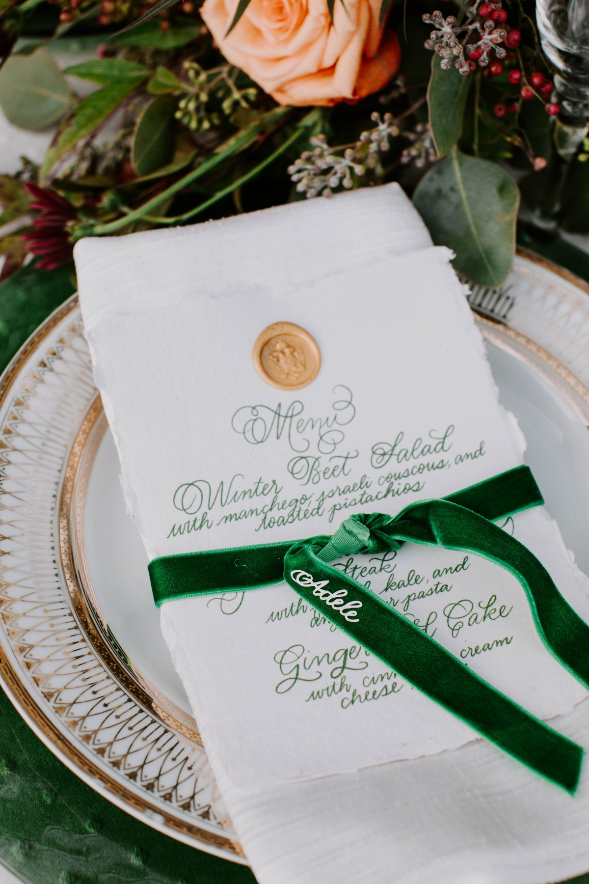 Emerald green and gold place setting for a wedding