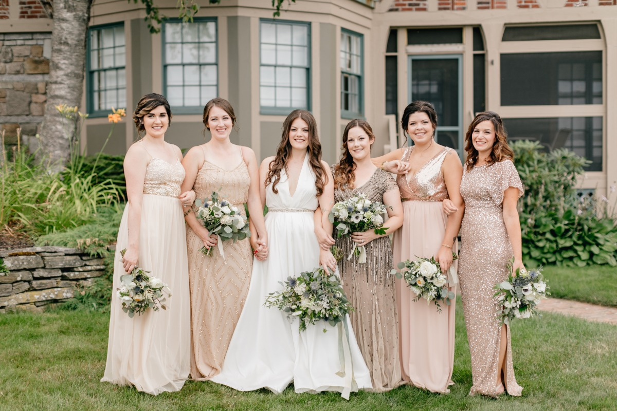 Bridesmaids in mix and match gold dresses