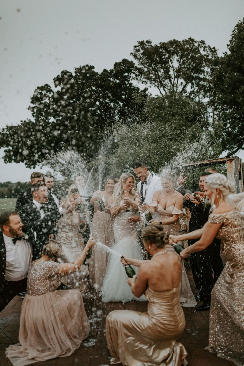 Champagne spray with the wedding party