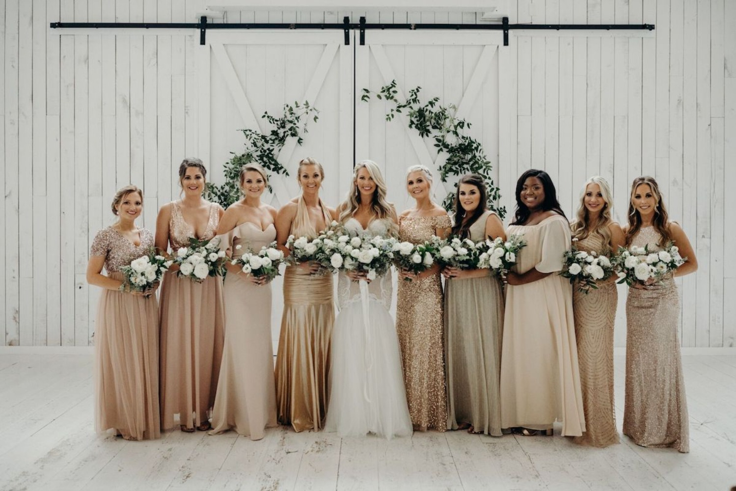 Bridesmaids in mismatched gold dresses