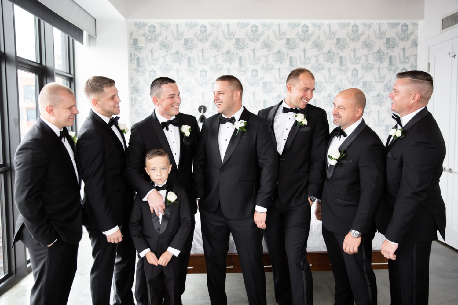 groom and his men in classic tuxedos
