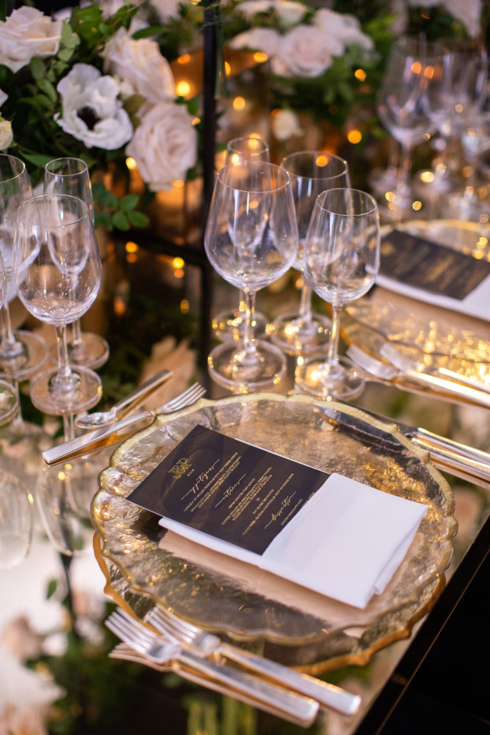 gold and black wedding place setting