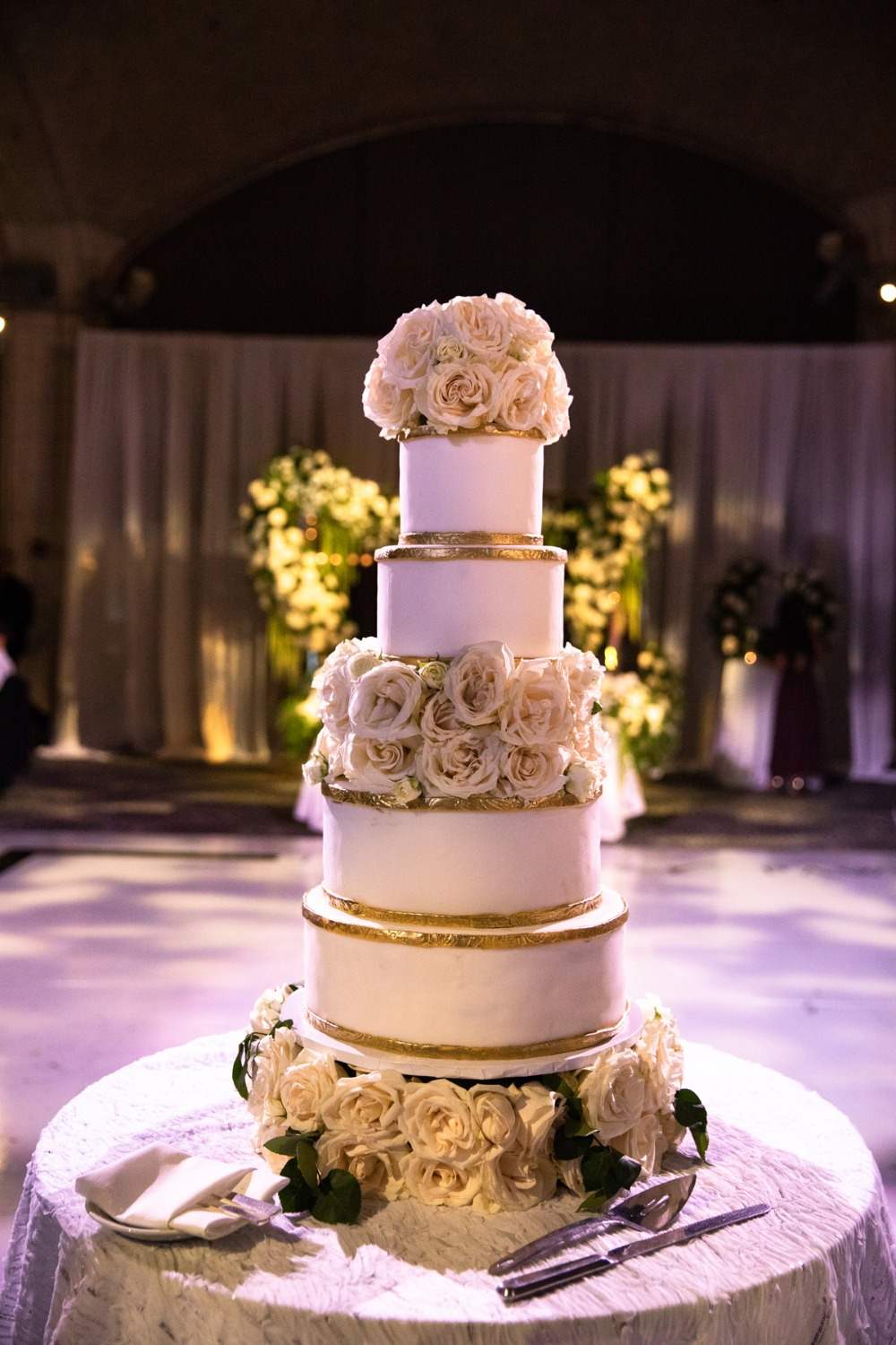glam gold and white flower topped wedding cake