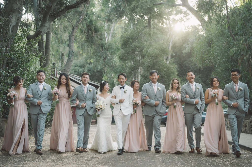 This shot is perfectly dreamy with the bridal party in blush pink and groomsmen in light grey. The colors complemented each other beautifully