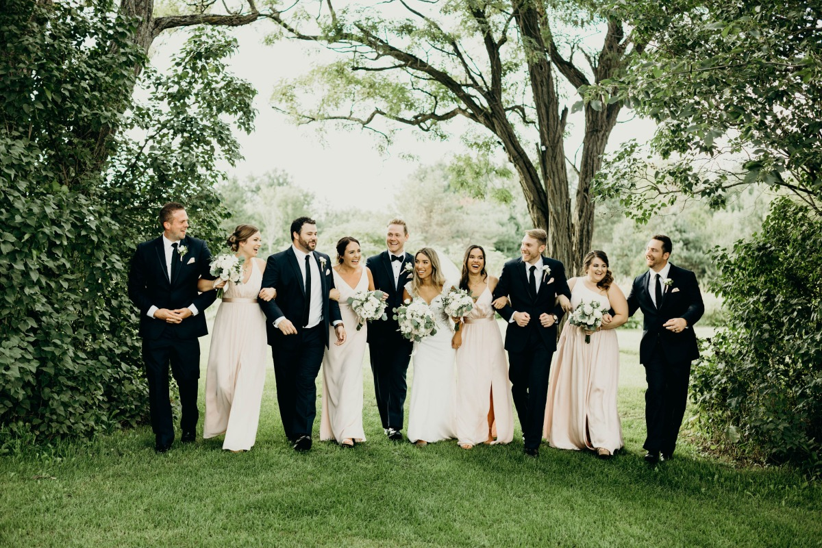 formal wedding party in black and blush