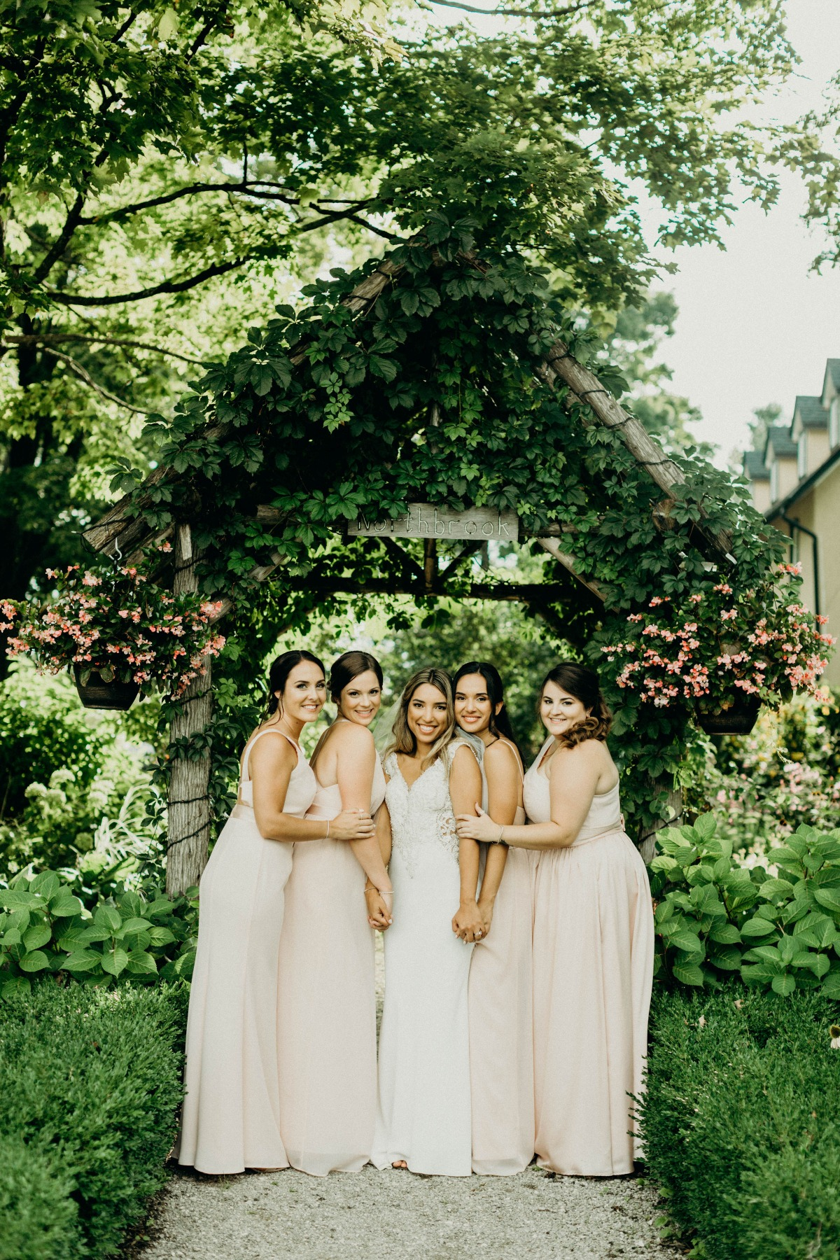 garden wedding with bridesmaids in blush