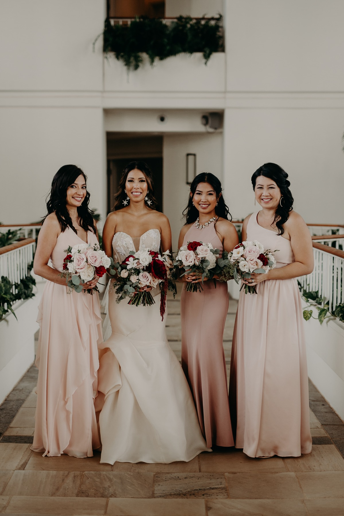 bridesmaid in assorted blush dresses