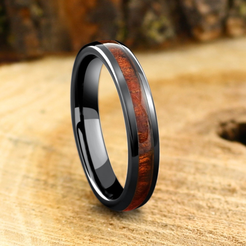 Mens or women's wood wedding ring. This wood ring has been crafted out of high tech ceramic and inlaid with natural koa wood. Also