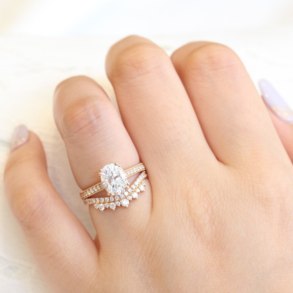 Breathtakingly gorgeous and unique creation! This moissanite bridal set features a moissanite solitaire engagement ring set in 14k