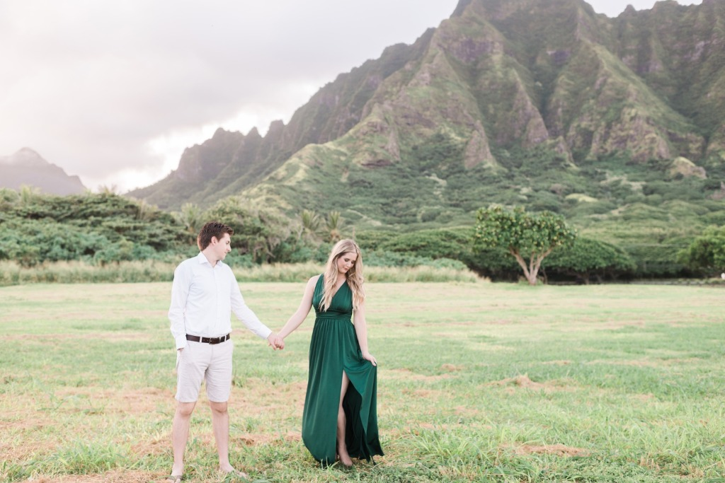 See Lexie and Joe's engagement session at Kualoa Regional Park overlooking the famous Jurassic Park mountains in Hawaii! They are