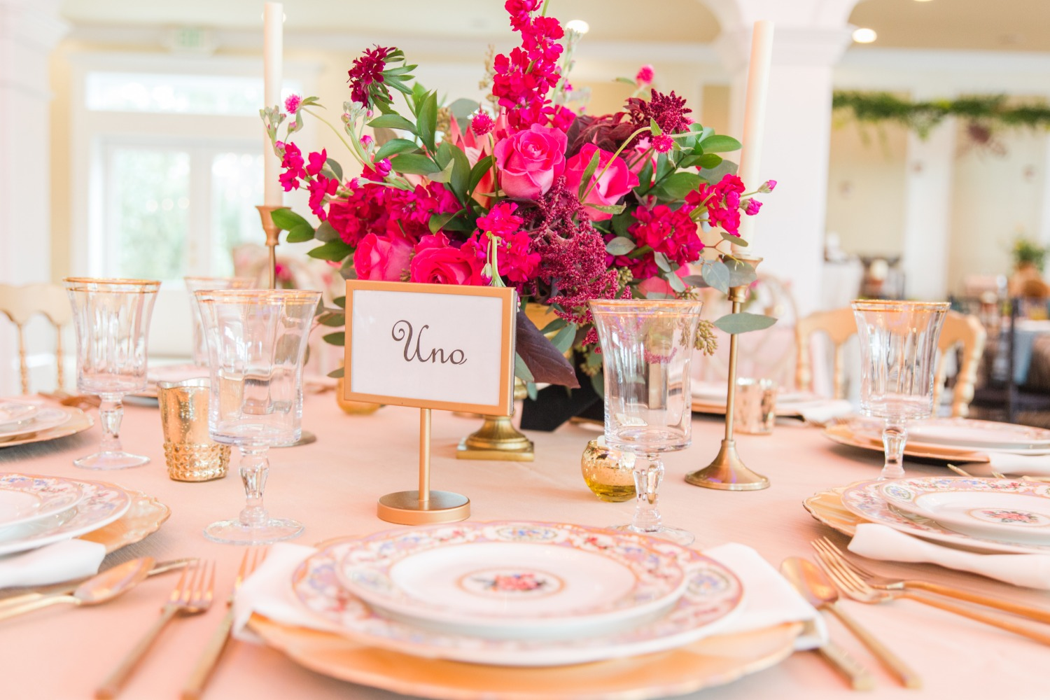 gold and bright pink wedding table