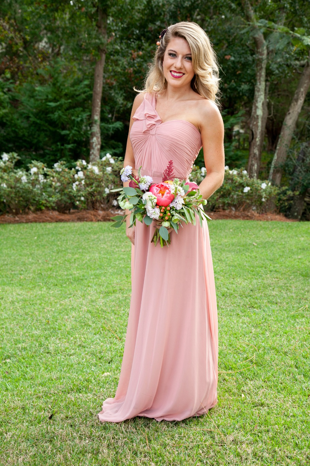 bridesmaid in single shoulder pink dress