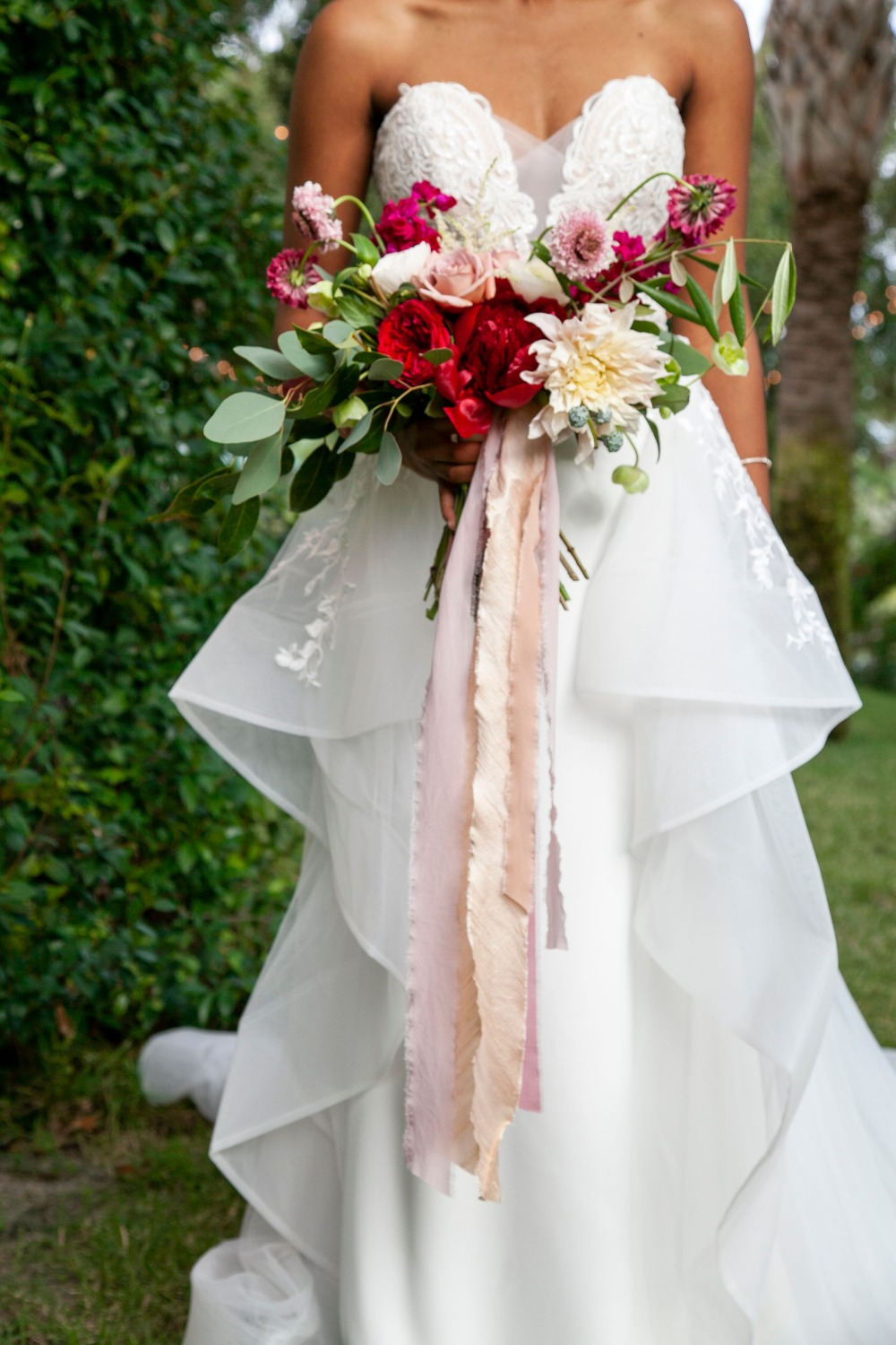 wedding dress and pink bouquet