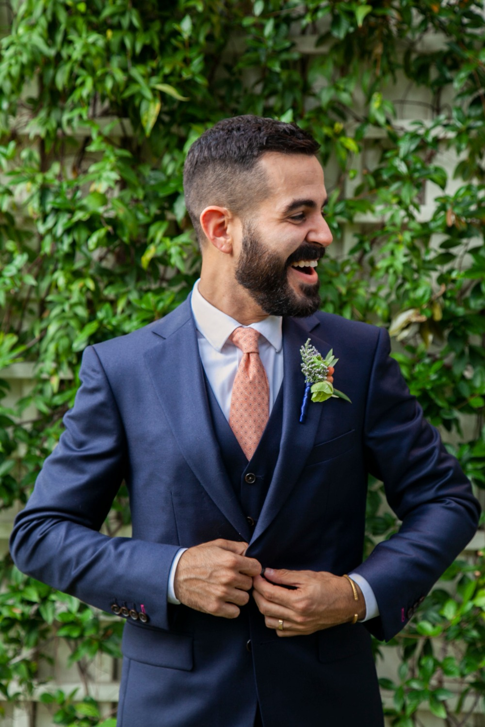 groom in navy blue suit