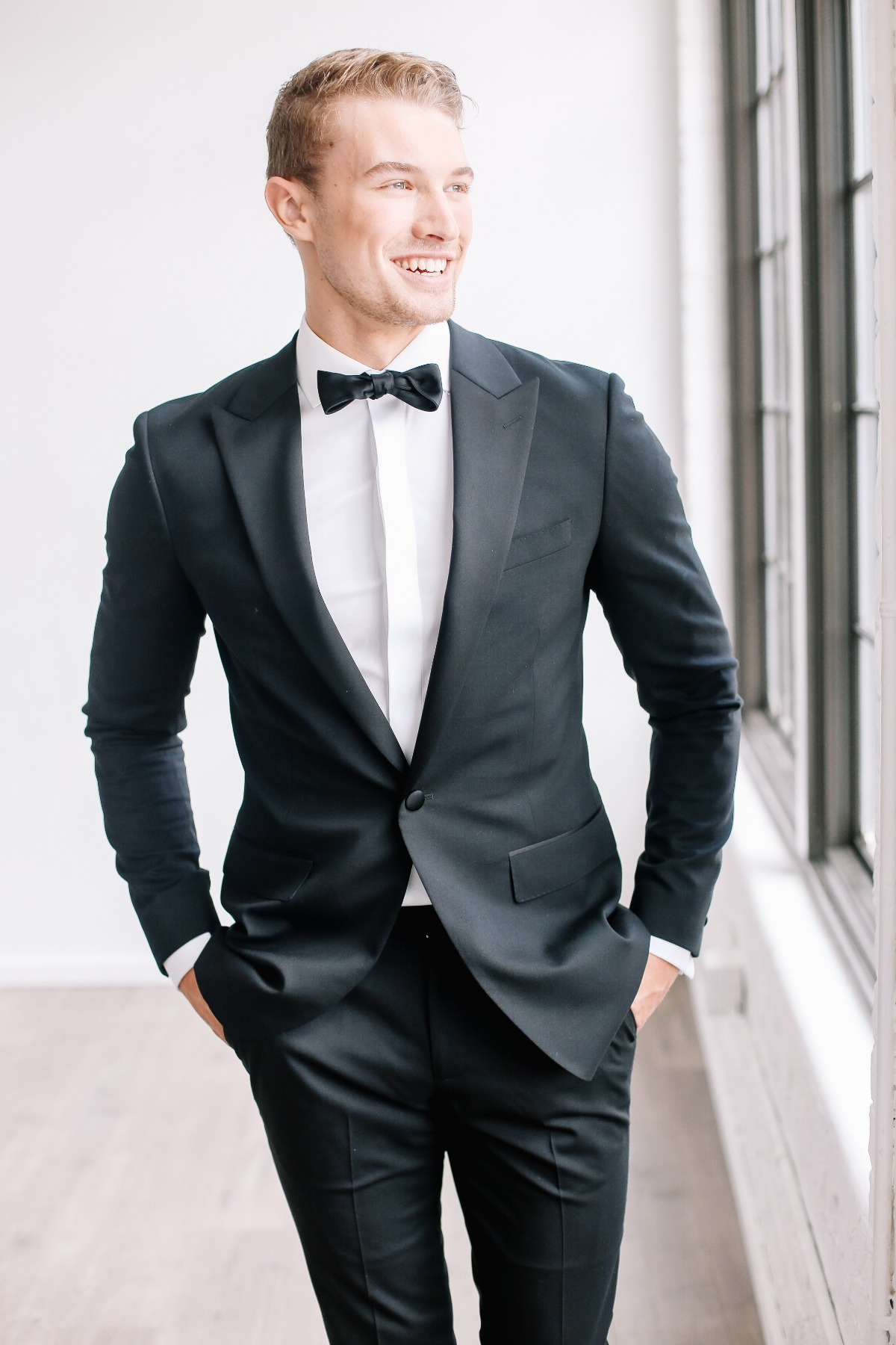 Stylish groom in black tie