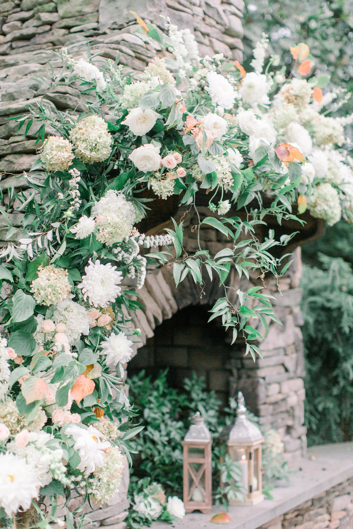 floral accented wedding hearth backdrop