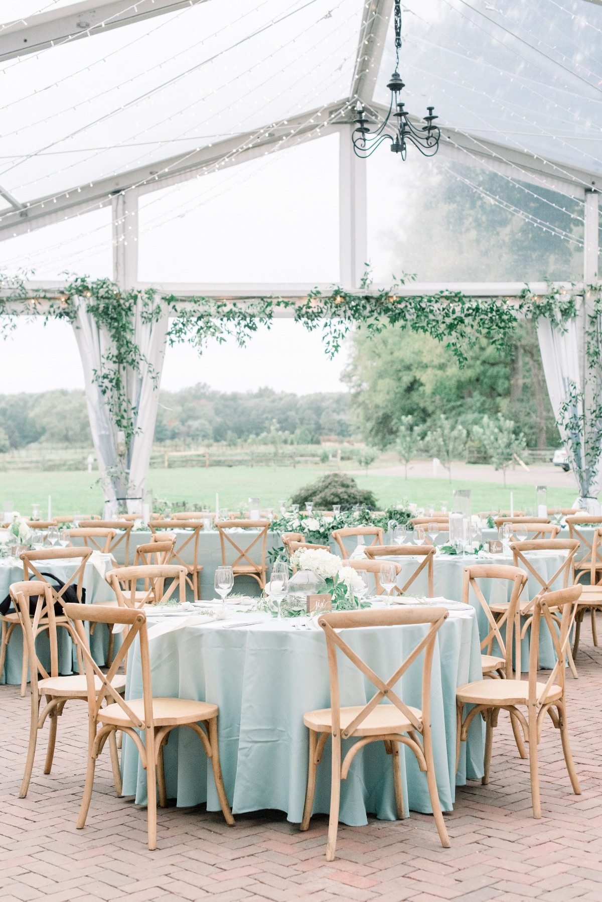pastel green tented wedding reception