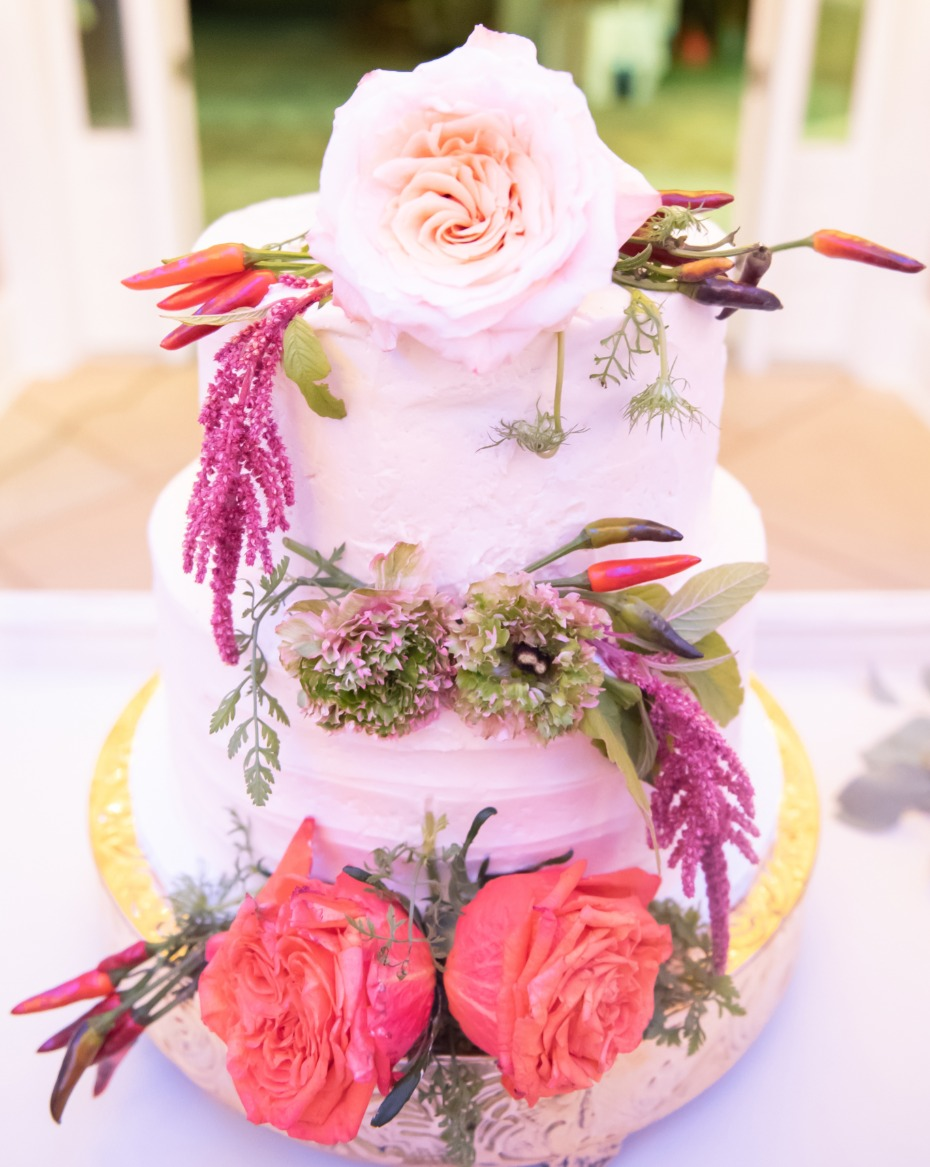floral and pepper topped wedding cake