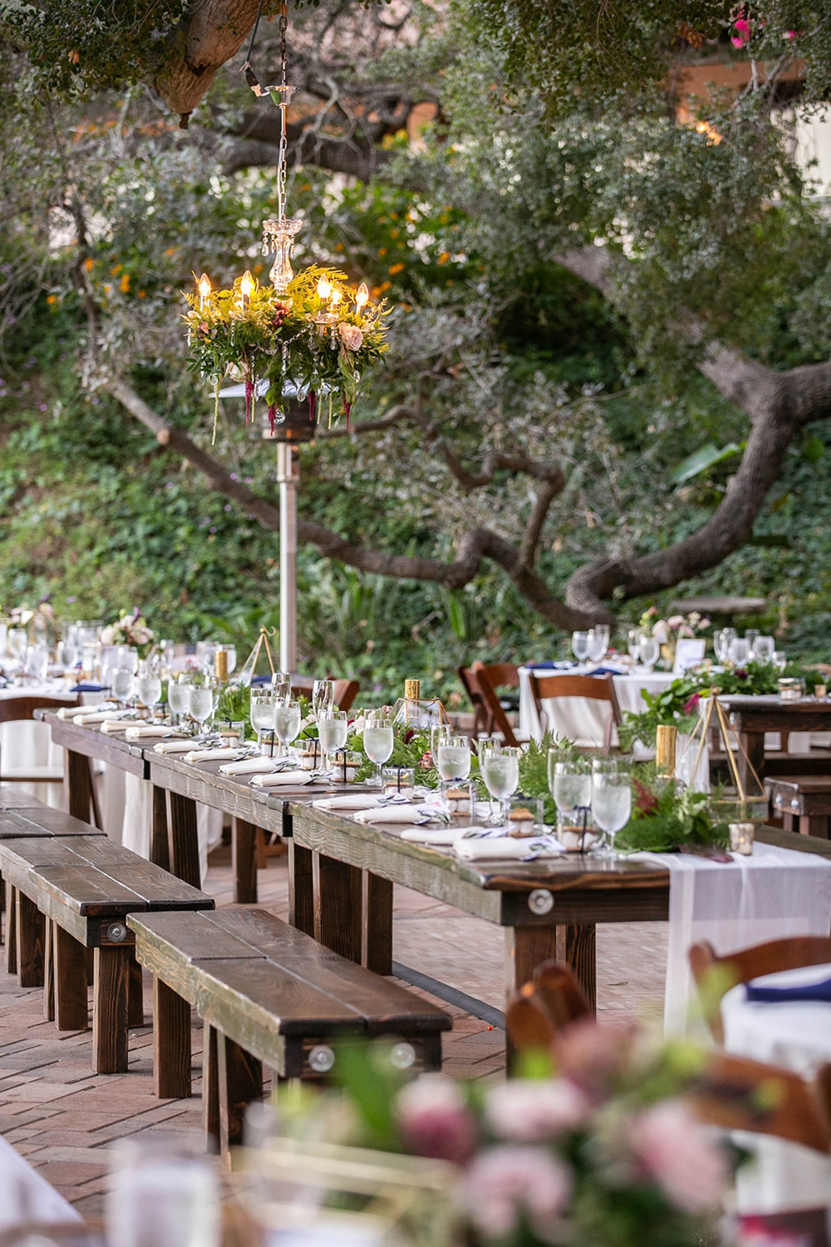 family style seating and outdoor chandeliers.
