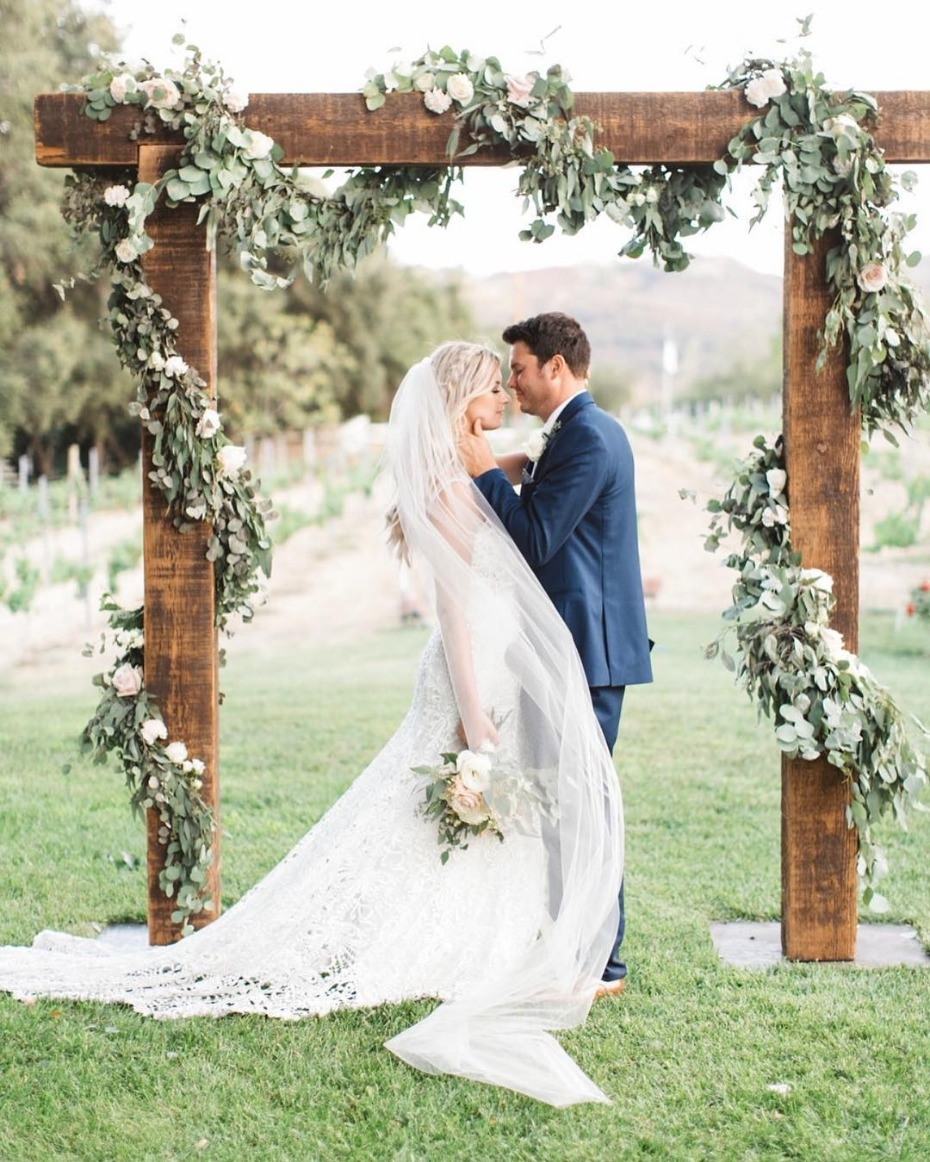 Floral garland on wedding ceremony arbor