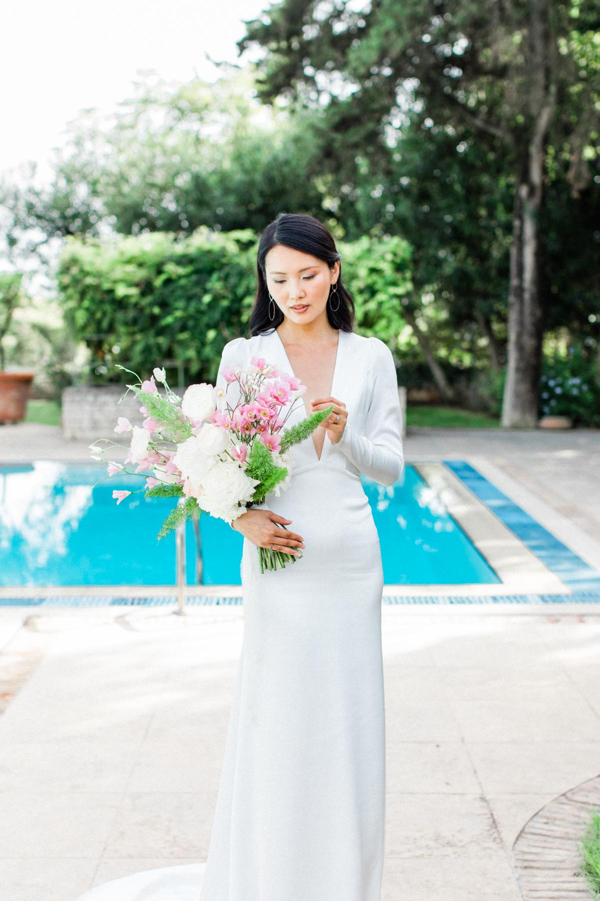 bride in chic plunging v neckline gown