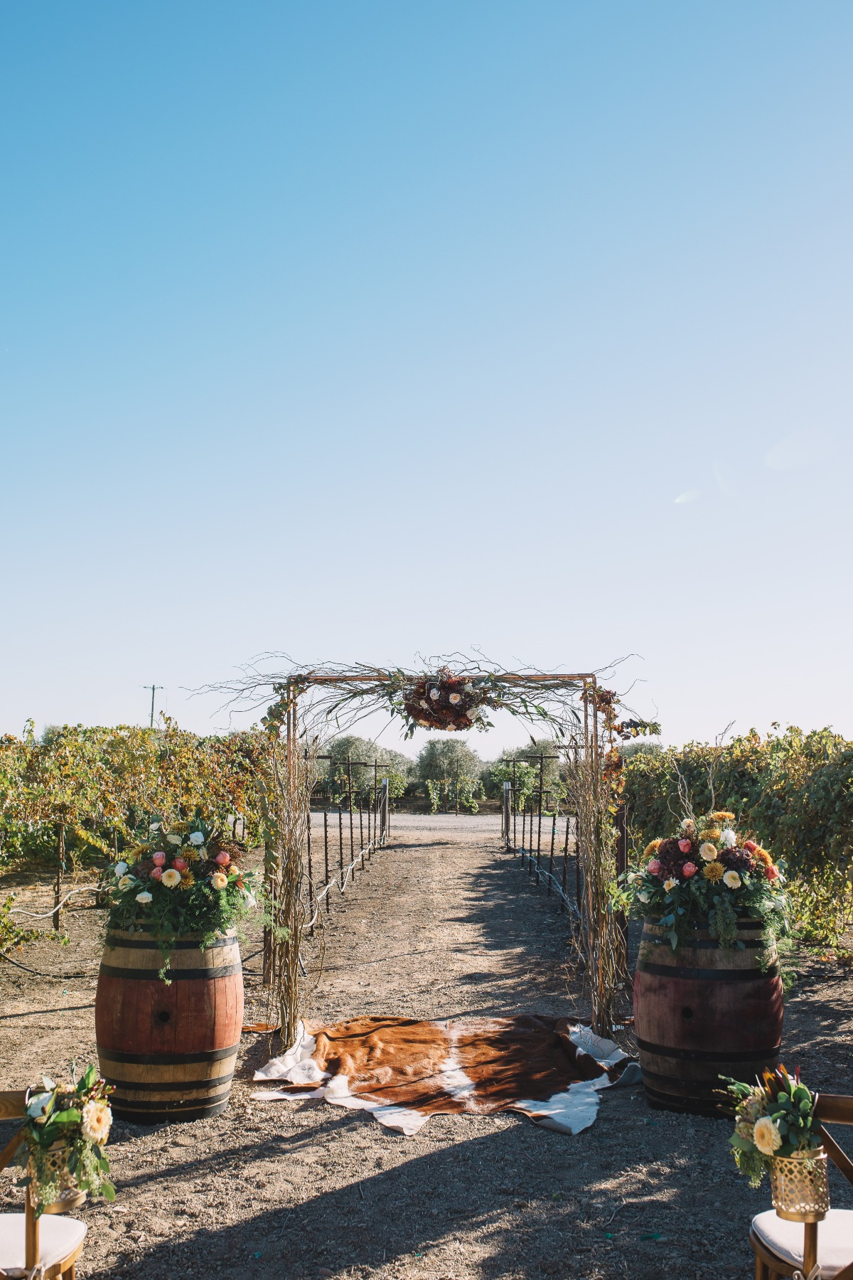 rustic chic wedding ceremony at a vineyard