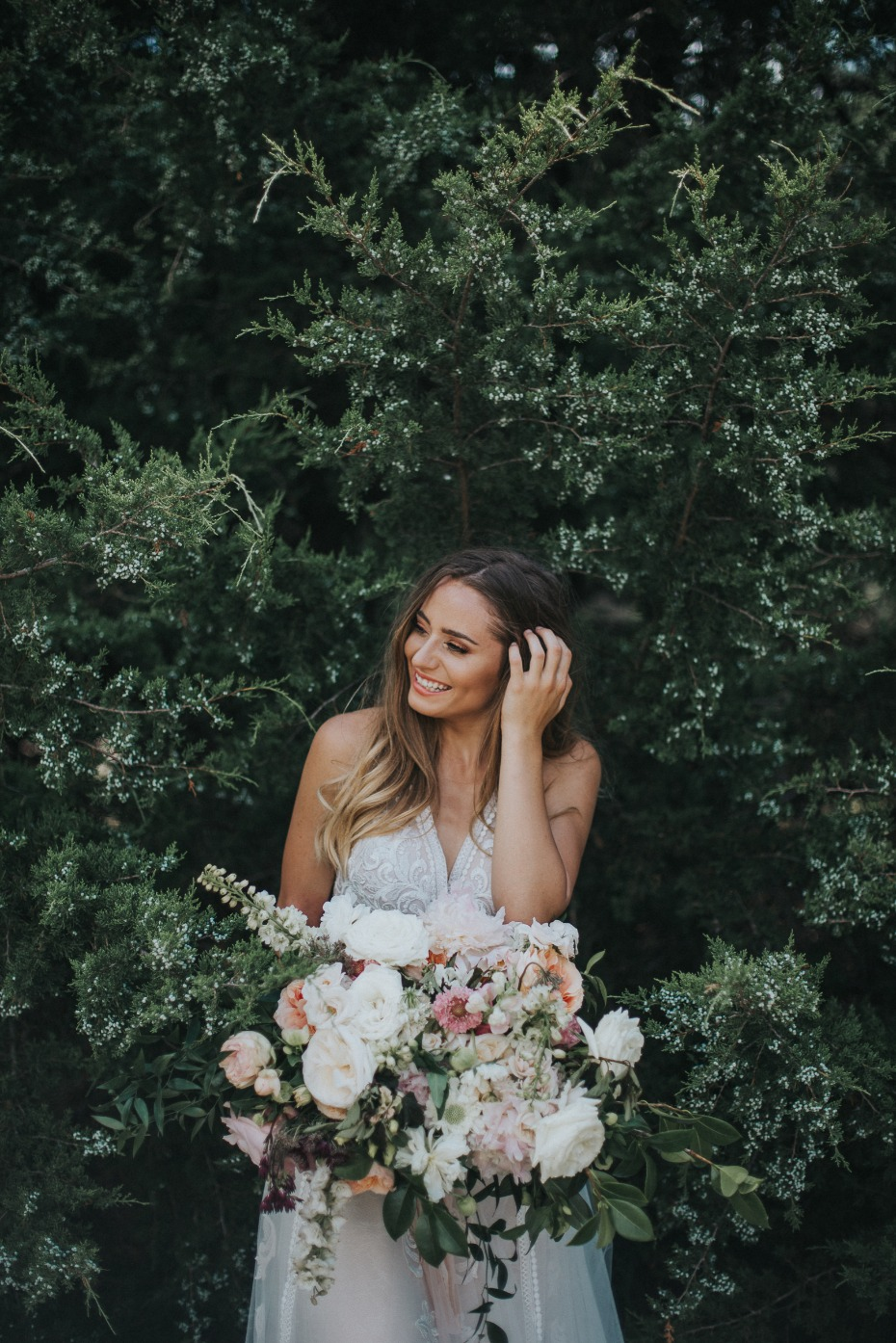 Wild Hill Flowers and Events Bride In Front of Trees with Bouquets