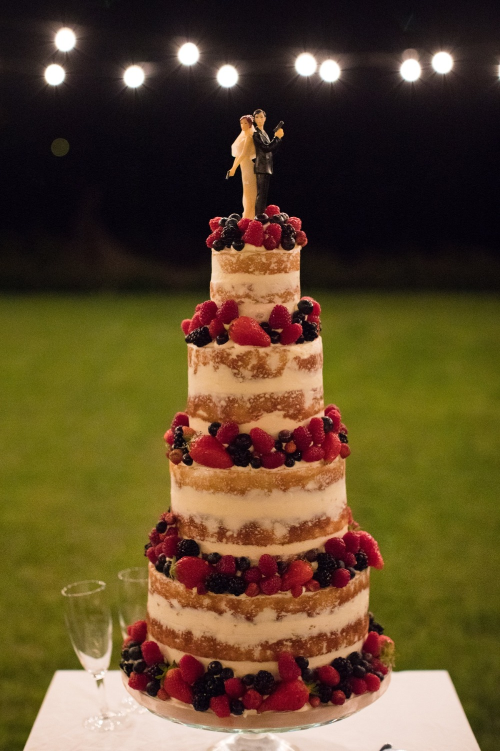 berry topped wedding cake with James Bond topper