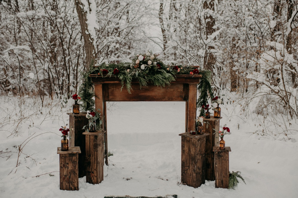 cozy winter wedding ceremony backdrop