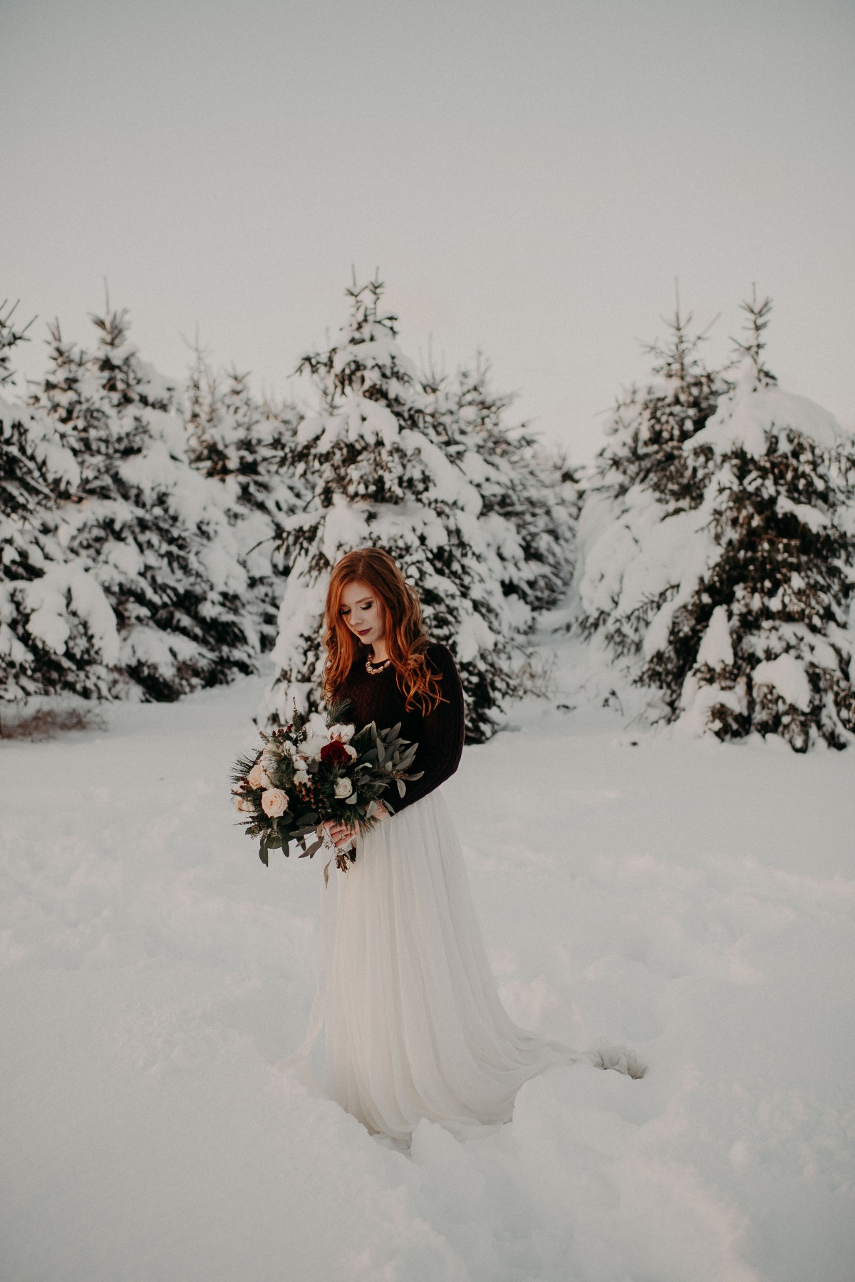 cozy bridal look in the snow
