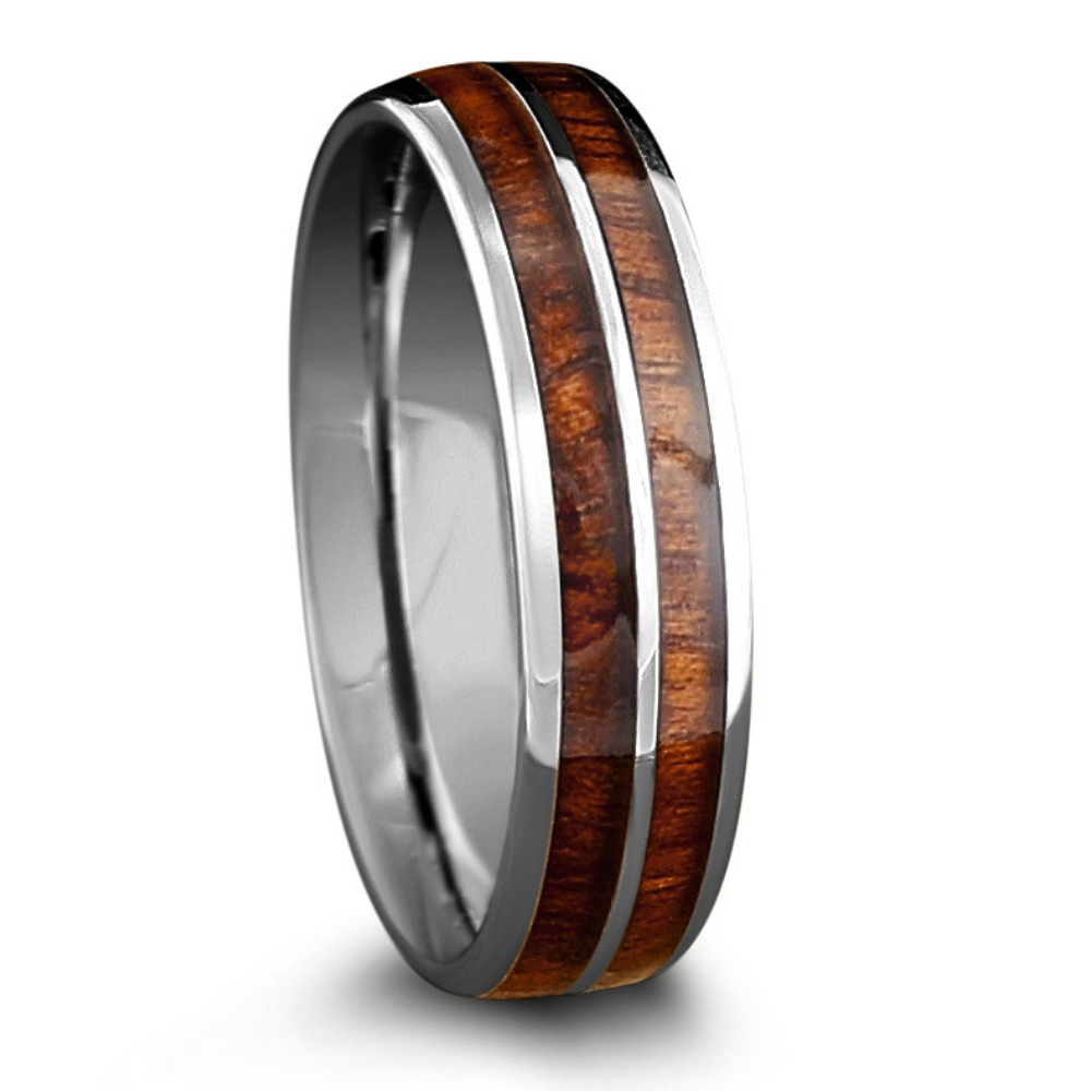 The silver 6mm barrel wood ring. Crafted out of tungsten and inlaid with natural koa wood.