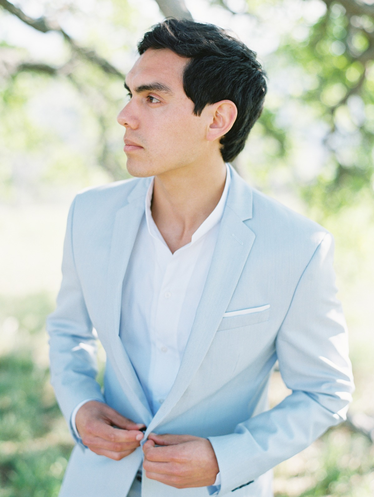 groom in light blue suit