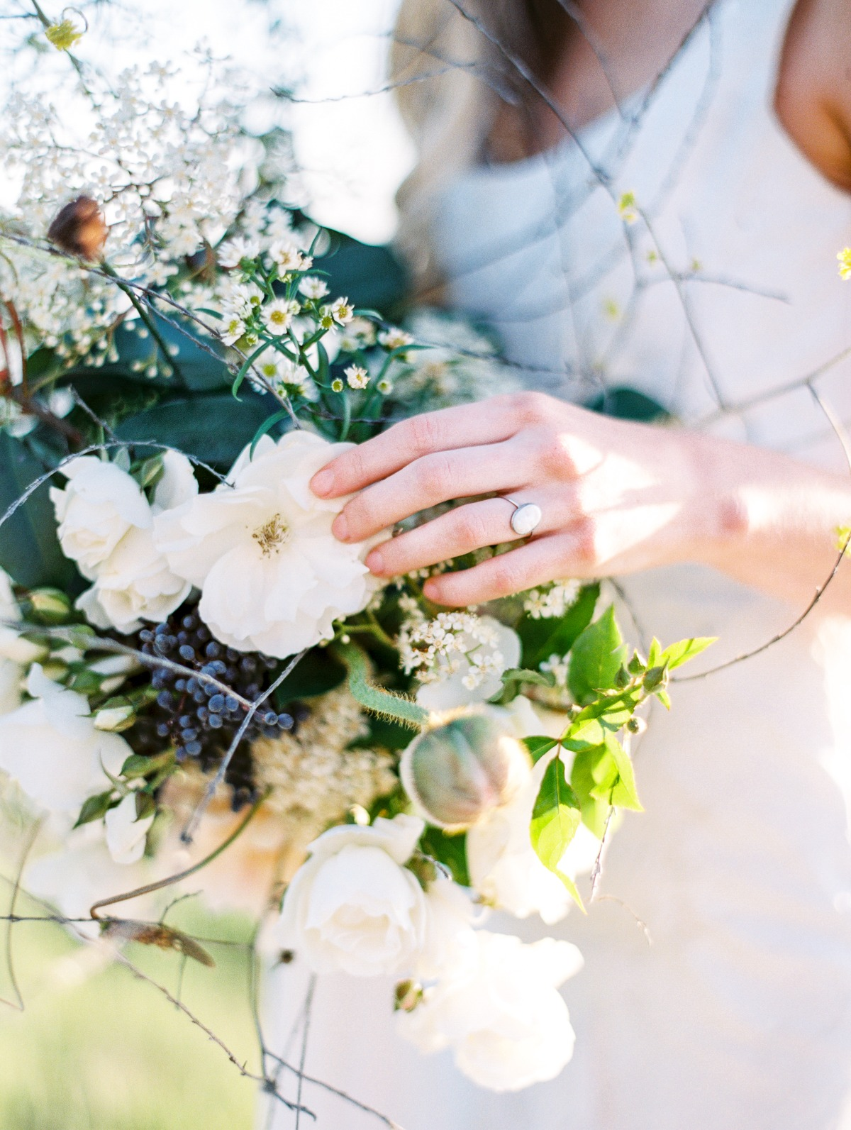 wedding ring and wild flower style bouquet
