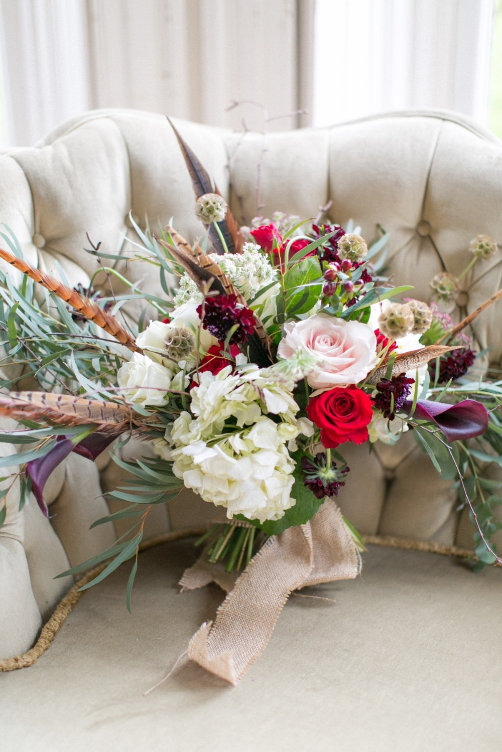 Winter wedding bouquet with feathers