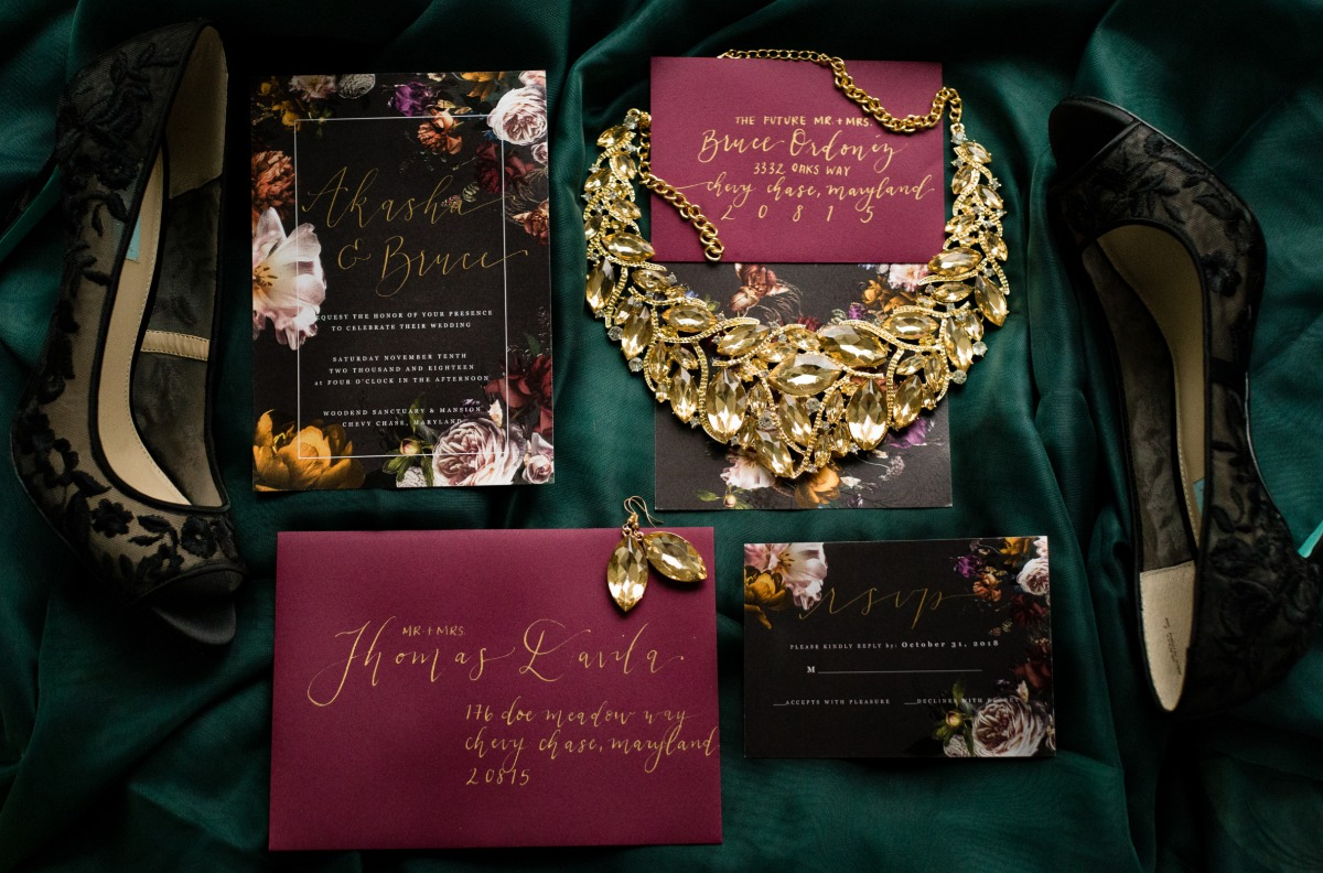 Moody floral wedding invitation suite