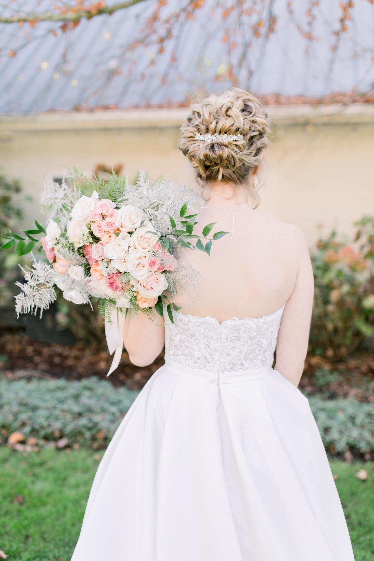 Bridal hair updo and wedding bouquet