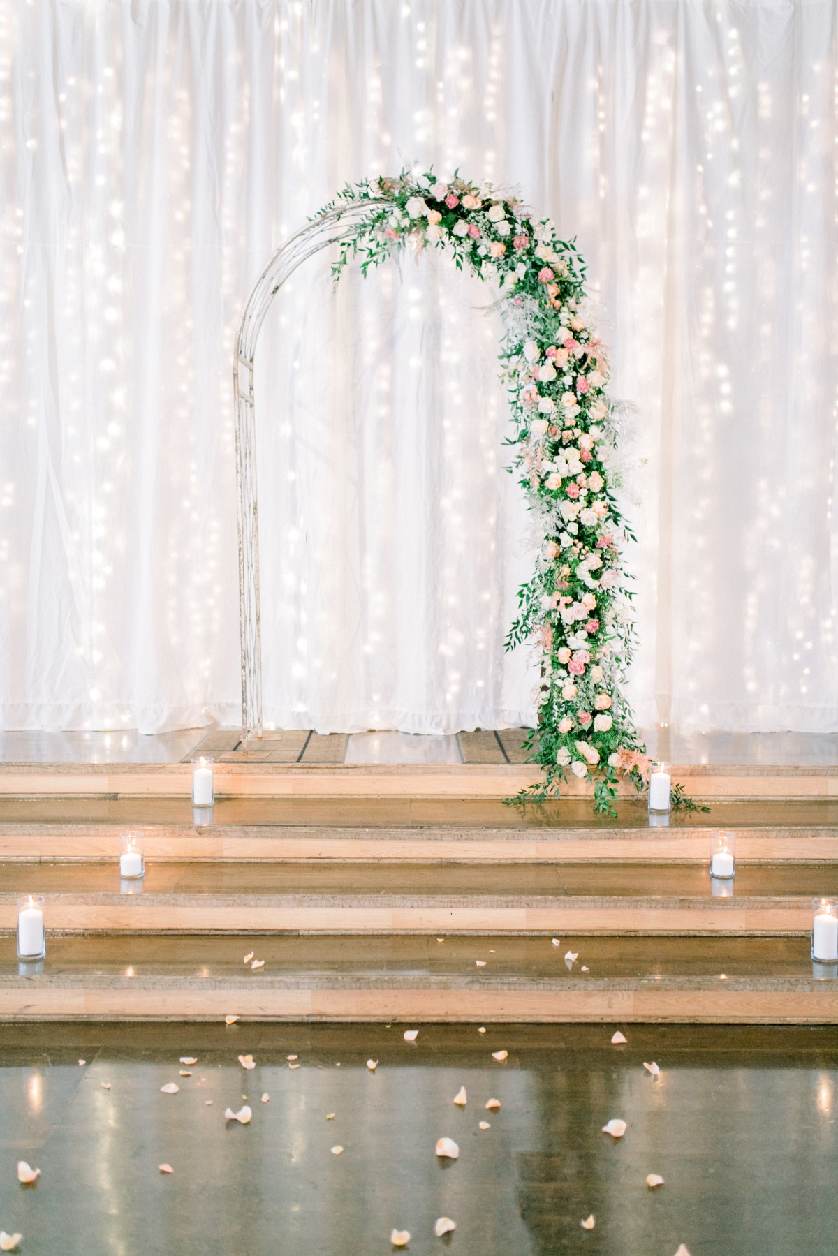 Ceremony arbor covered in florals
