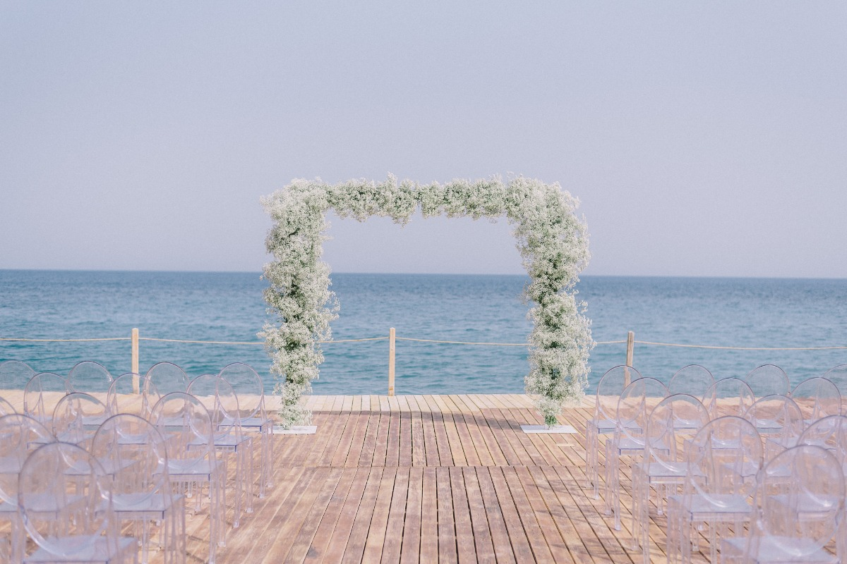 Babies breath ceremony arbor and acrylic chairs