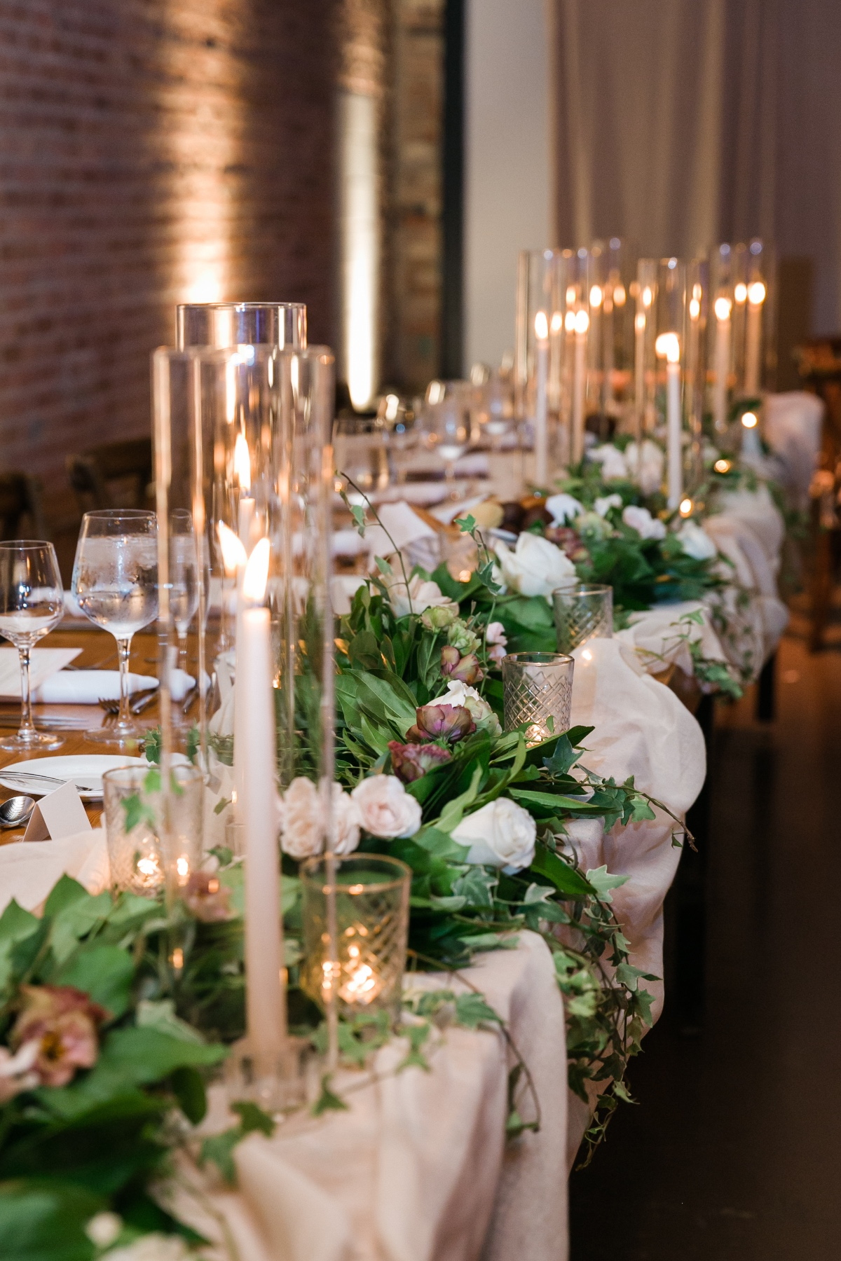 candle lit wedding party table