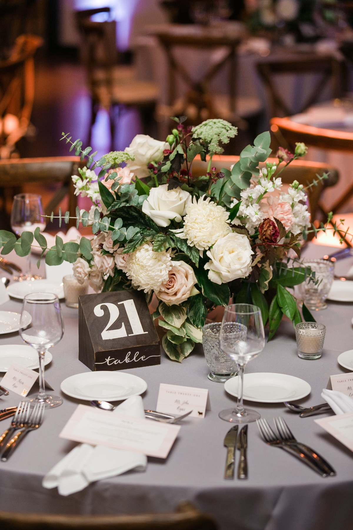 wood block table number and floral centerpiece