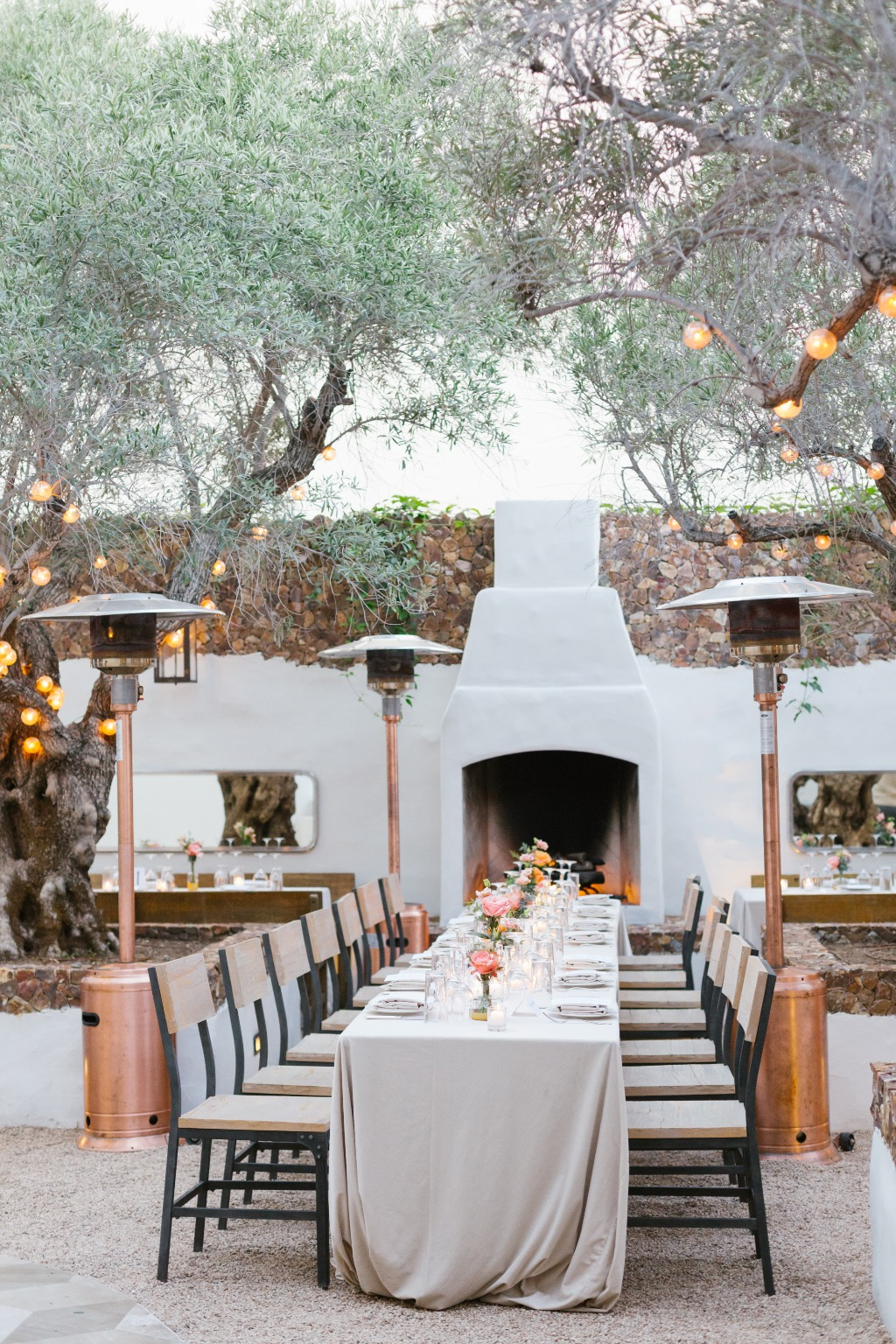 Beautiful reception at Smithy restaurant in Santa Barbara! The candles and palette of peach and pink florals made for a gorgeous evening